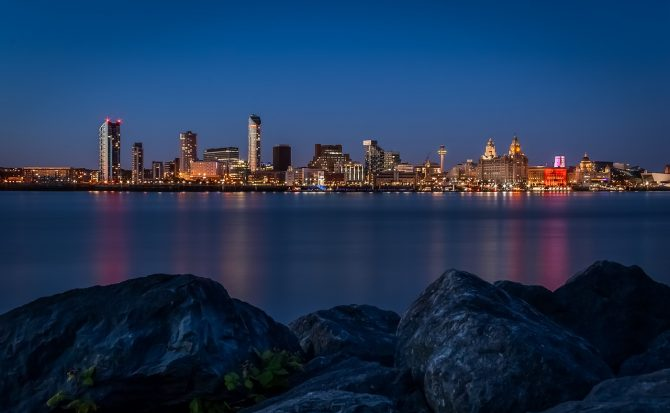 Liverpool waterfront seen across the river Mersey.