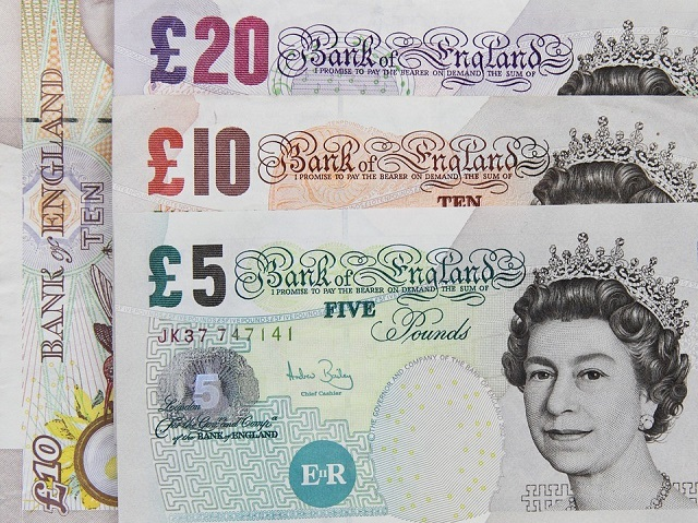 a £5 note, a £10 note and a £20 note