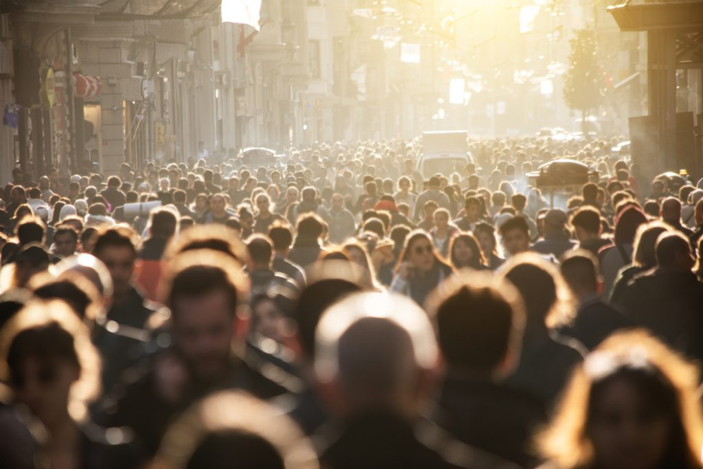 A crowd of people outdoors with blurred faces