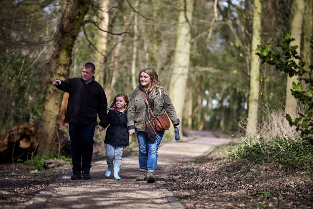 Family going for a walk in the woods.
